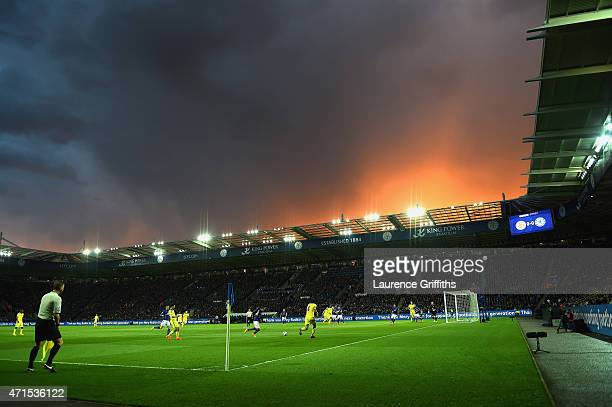 A general view of play as stormy skies hang over the stadium during the Barclays Premier League match between Leicester City and Chelsea at The King...