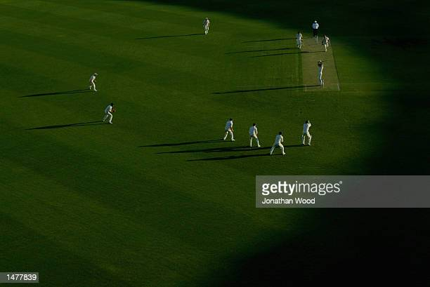 General view of play as the sun goes down during the Pura Cup match between the Queensland Bulls and the New South Wales Blues played at the Gabba in...
