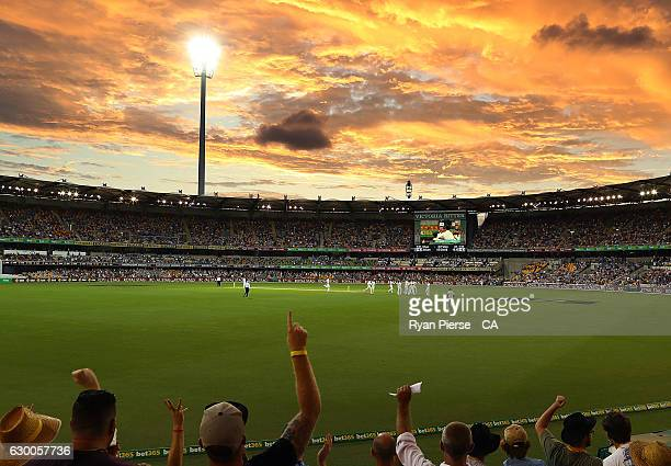 A general view of play at sunset during day two of the First Test match between Australia and Pakistan at The Gabba on December 16 2016 in Brisbane...