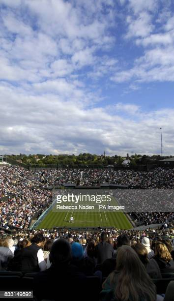 A general view of play between Spain's Rafael Nadal and USA's Mardy Fish on the roofless centre court during The All England Lawn Tennis Championship...