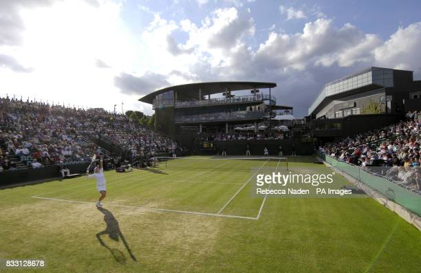 A general view of play between Switzerland's Martina Hingis and USA's Laura Granville during The All England Lawn Tennis Championship at Wimbledon