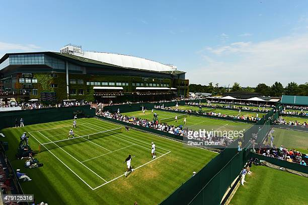 A general view of play on courts 17 15 14 during day three of the Wimbledon Lawn Tennis Championships at the All England Lawn Tennis and Croquet Club...