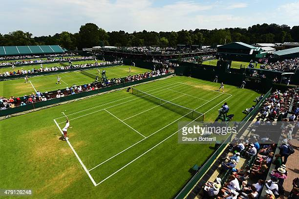 A general view of play on the outside courts during day three of the Wimbledon Lawn Tennis Championships at the All England Lawn Tennis and Croquet...