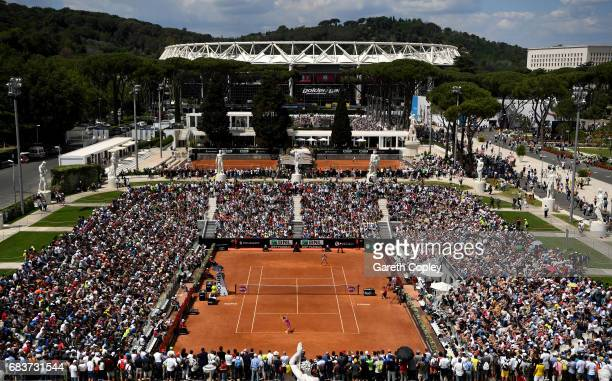General view of play the first round match between Roberto Vinci of Italy and Ekaterina Makarova of Russia on the Pietrangeli court during their...