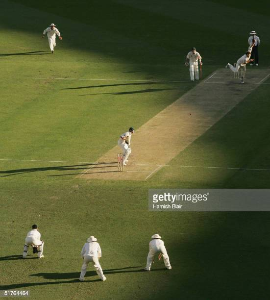 A general view of play with Kyle Mills of New Zealand bowling to Michael Clarke of Australia during day two of the first test between Australia and...