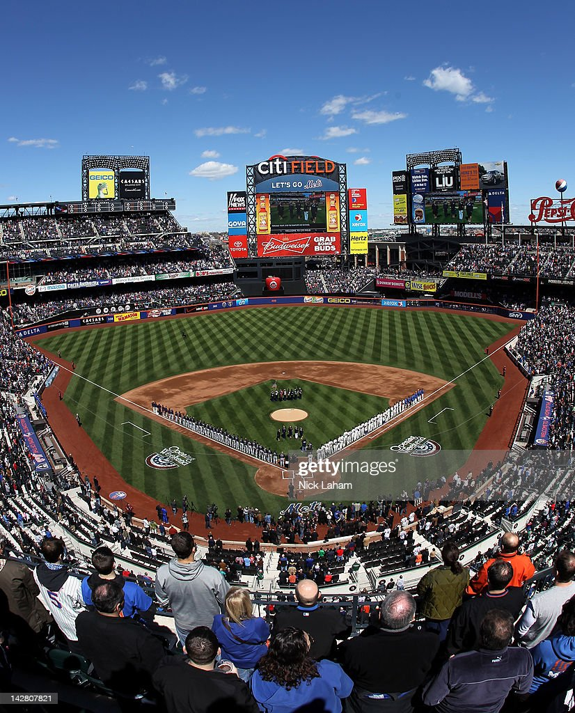 A general view of players and coaches from the New York Mets and the Atlanta Braves lined up on the foul line for the performance of the National Anthem during their Opening Day Game at Citi Field on April 5, 2012 in New York City.