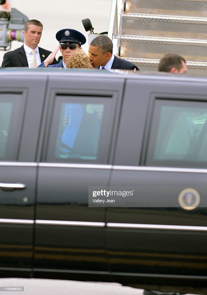 General view of President Barack Obama and DNC Chairperson U.S. Rep. Debbie Wasserman Schultz riding the presidential limo for a private DNC fundraising event at Miami International Airport on June 12, 2013 in Miami, Florida.