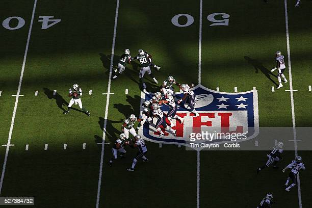 A general view of Quarterback Geno Smith New York Jets in action in the late afternoon sunshine showing the NFL logo and field markings during the...