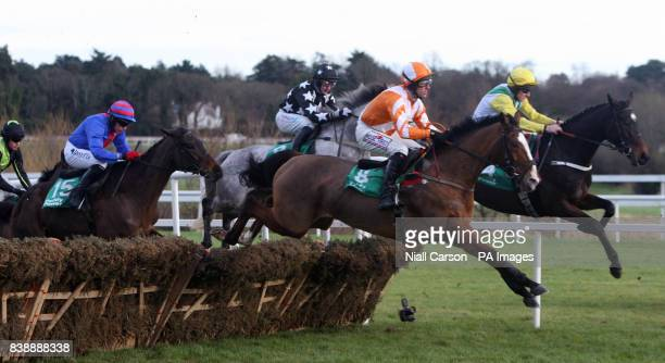 A general view of race action in the paddypowercom Android App Maiden Hurdle during day four of the Christmas Festival at Leoparstown Racecourse...