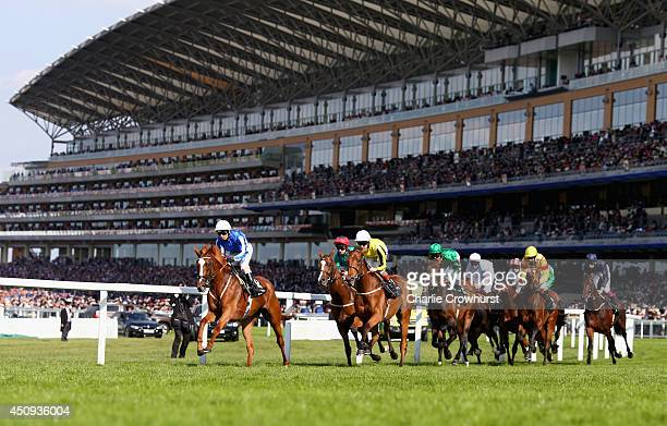 A general view of race goers watching riders during day four of Royal Ascot 2014 at Ascot Racecourse on June 20 2014 in Ascot England