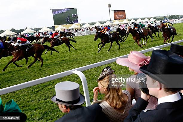 A general view of racegoers watching the riders during day four of Royal Ascot 2014 at Ascot Racecourse on June 20 2014 in Ascot England