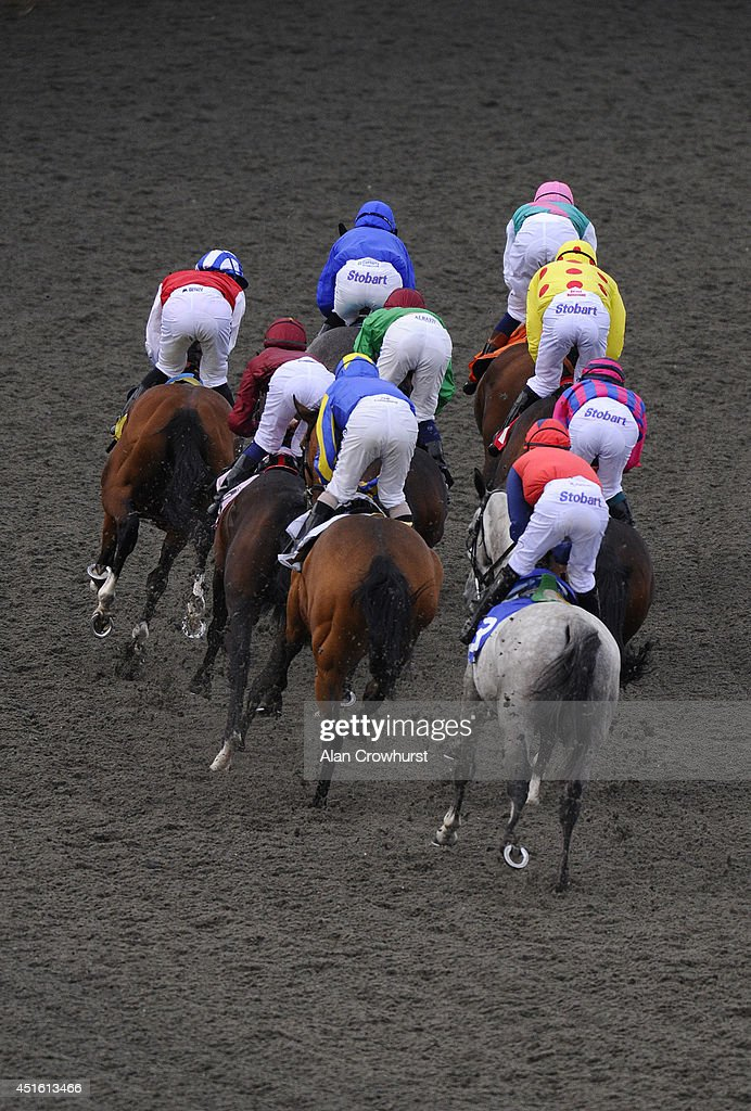 A general view of racing at Kempton Park racecourse on July 02, 2014 in Sunbury, England.