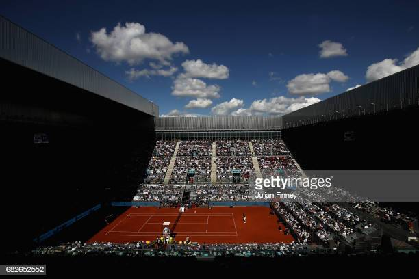 A general view of Rafael Nadal of Spain in action against Novak Djokovic of Serbia in the semi finals during day eight of the Mutua Madrid Open...