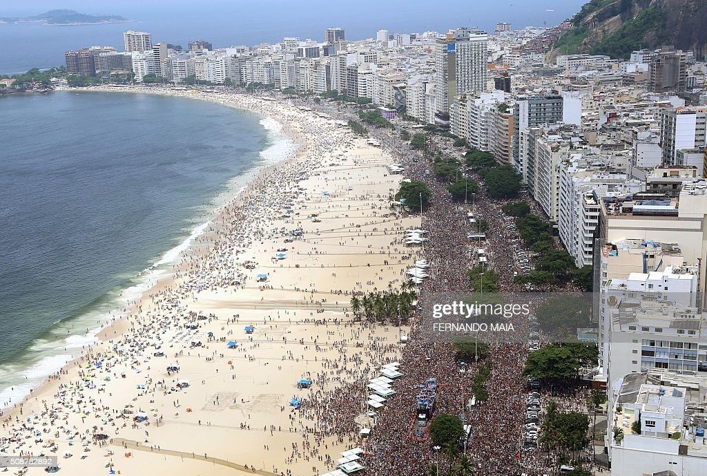 General view of revelers enjoying the 'A Favorita' carnival band parade on Copacabana Beach Rio de Janeiro Brazil on February 6 2016 Though Brazil's...