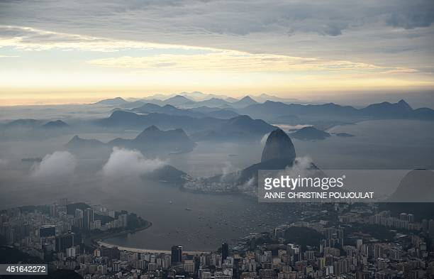 A general view of Rio is seen from the site of the Christ the Redeemer statue in Rio de Janeiro on July 3 2014 AFP PHOTO / ANNECHRISTINE POUJOULAT