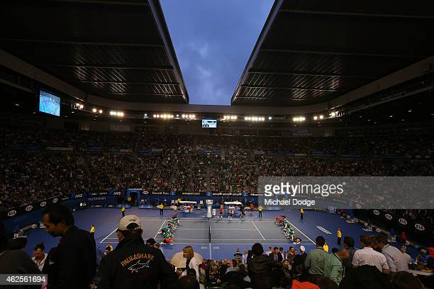 A general view of Rod Laver Arena as the roof closes and ball kids dry the court during day 13 of the 2015 Australian Open at Melbourne Park on...