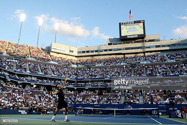A general view of Roger Federer of Switzerland serving against Juan Martin Del Potro of Argentina during the Men's Singles final on day fifteen of...
