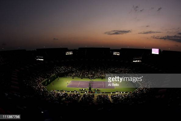 A general view of Roger Federer of Switzerland serving against Rafael Nadal of Spain during their men's semifinal match at the Sony Ericsson Open at...