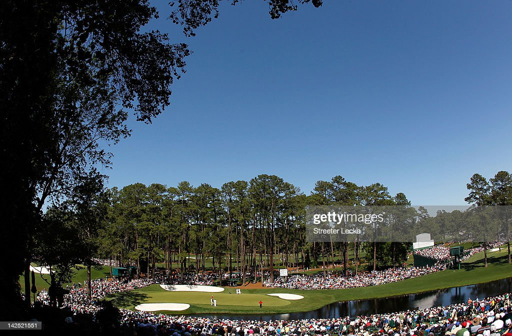 A general view of Rory McIlroy of Northern Ireland Bubba Watson of the United States and Angel Cabrera of Argentina putting on the 16th hole during...