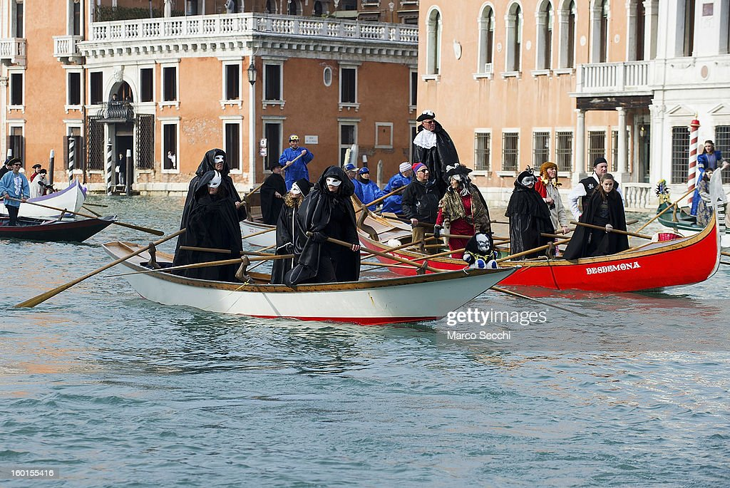 A general view of rowers dressed with costumes and masks taking part in the Water Parade 2013 on the Grand Canal on January 27, 2013 in Venice, Italy. The 2013 Carnival of Venice will run from January 26 - February 12 and includes a program of gala dinners, parades, dances, masked balls and music events.