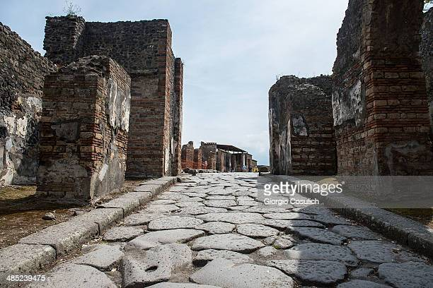 General view of ruins along an ancient road at the archaeological area on April 12 2014 in Pompei Italy The Italian government has enacted a series...