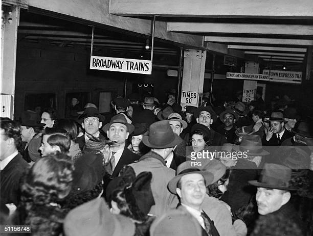 General view of rush hour crowd on the BMT platform in the Times Square subway station in New York 1940s