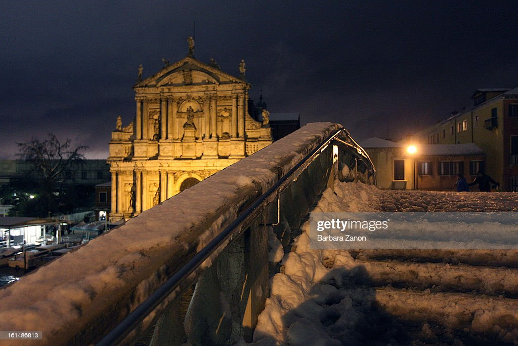 General view of Scalzi Bridge during a heavy snow and high tide on February 11, 2013 in Venice, Italy. Heavy snow, high water, rain and wind hit the city today and sea level rose to 145cm.