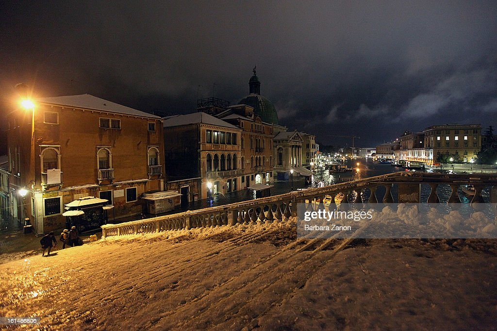 General view of Scalzi Bridge during heavy snowfall and high tide on February 11, 2013 in Venice, Italy. Heavy snow, high water, rain and wind hit the city today and sea level rose to 145cm.