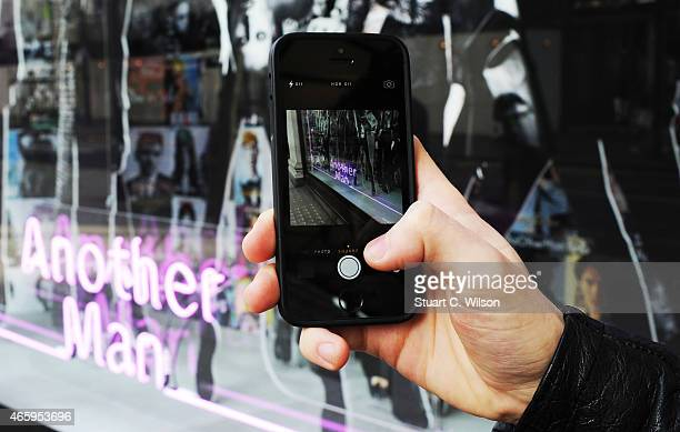 A general view of shoppers interacting with the Selfridges 'AnOther Magazine' windows to launch a digital issue of the magazine at Selfridges on...