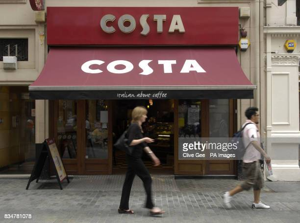 General view of shoppers walking past a Costa Coffee store on Argyll Street in London