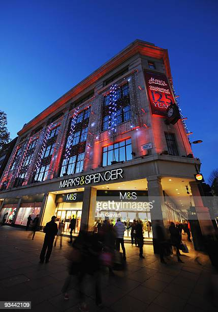General view of shoppers walking past the entrance to the Marks Spencer store on Oxford Street on November 26 2009 in London England