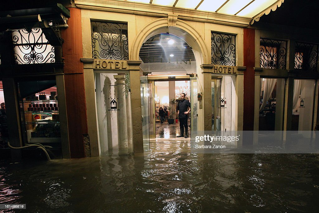 General view of shops and hotels during a heavy snow and high tide at Lista di Spagna on February 11, 2013 in Venice, Italy. Heavy snow, high water, rain and wind hit the city today and sea level rose to 145cm.