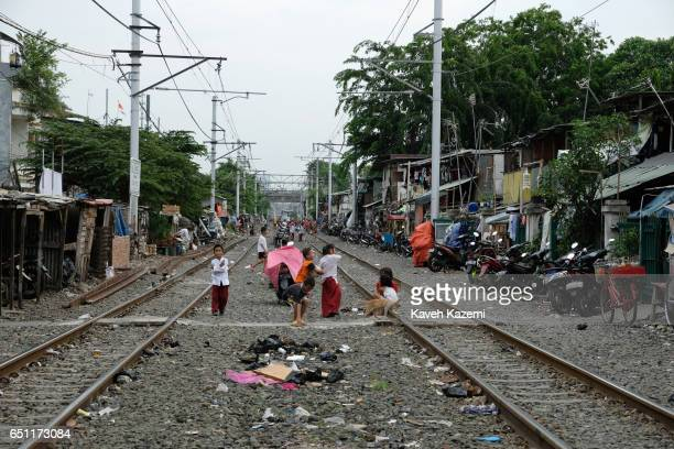 A general view of slum dwellers huts built by the rairoad track in Kota City where kids seen playing on November 25 2016 in Jakarta Indonesia The...