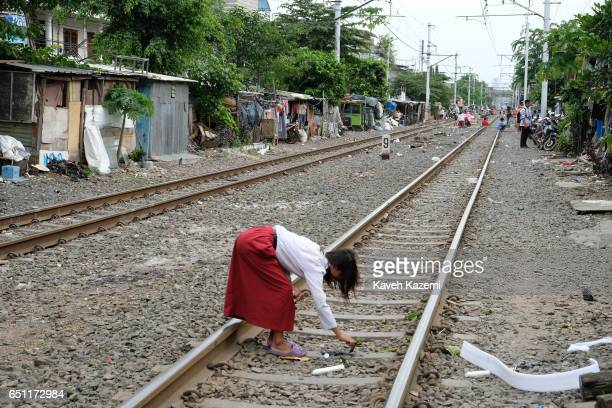 A general view of slum dwellers makeshift houses built by the rairoad track in Kota City wherea young girl seen playing on November 25 2016 in...