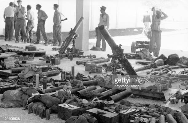 General view of some of the arms which belonged to the Cuban and American mercenary soldiers who landed at the Bay of Pigs in an attempt to overthrow...