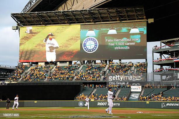General view of starting pitcher Felix Hernandez of the Seattle Mariners waves to the crowd as he walks off the field after striking out David Murphy...
