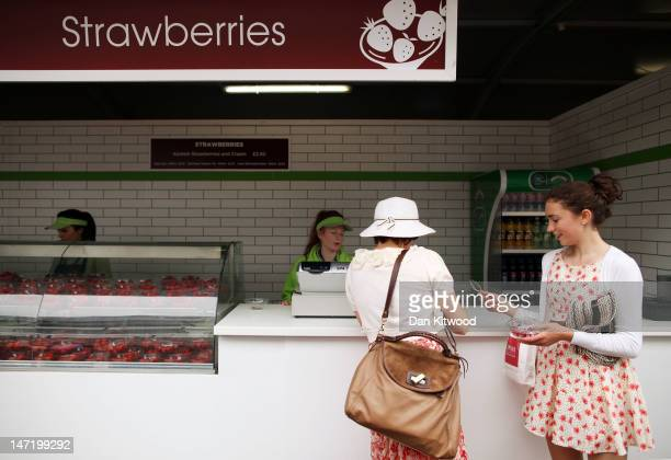 A general view of strawberry vendors on day three of the Wimbledon Lawn Tennis Championships at the All England Lawn Tennis and Croquet Club on June...