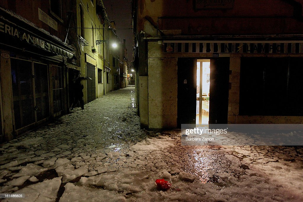 General view of streets during a heavy snow and high tide on February 11, 2013 in Venice, Italy. Heavy snow, high water, rain and wind hit the city today and sea level rose to 145cm.