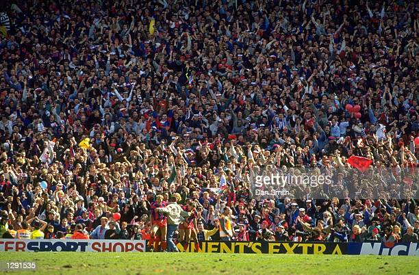 General view of supporters celebrating after Pardew of Crystal Palace scores the winning goal during the FA Cup SemiFinal against Liverpool at Villa...