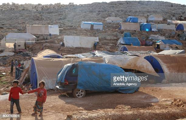 A general view of Syrians' shelters during Muslim's holy month of Ramadan in Idlib Syria on June 23 2017 Ahead of Eid al Fitr Syrian people who fled...
