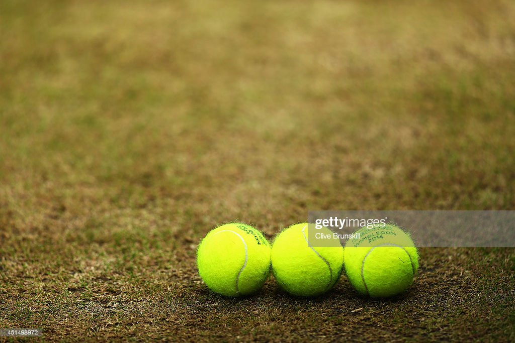 General view of Tennis balls on the grass on day seven of the Wimbledon Lawn Tennis Championships at the All England Lawn Tennis and Croquet Club on...