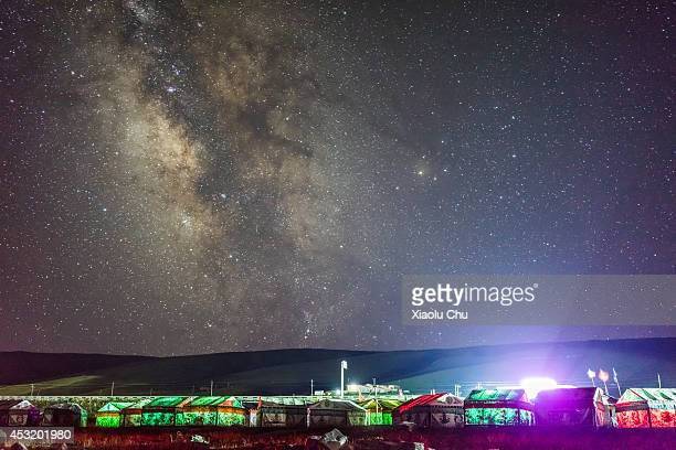 A general view of tens and the Milk Way in night at the shore of Qinghai Like Qinghai Lakethe sacred lake of the Tibetan Buddhism is the largest salt...