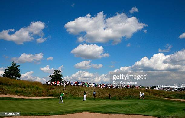 A general view of the 14th green as Adam Scott of Australia putts during the First Round of the BMW Championship at Conway Farms Golf Club on...