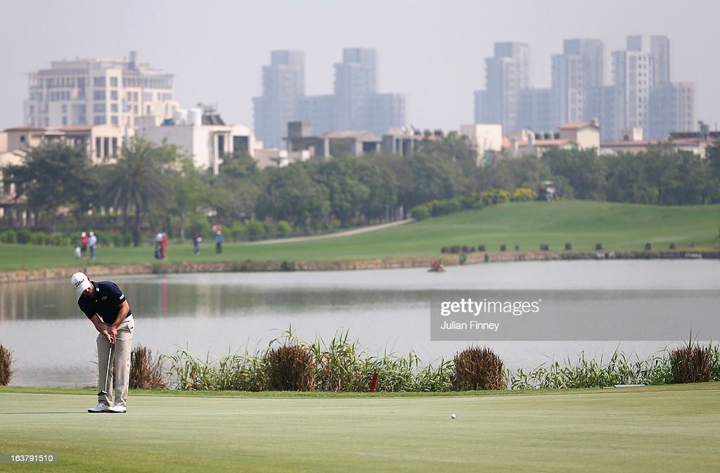 A general view of the 15th green as Paul Waring of England putts during day three of the Avantha Masters at Jaypee Greens Golf Club on March 16, 2013 in Delhi, India.