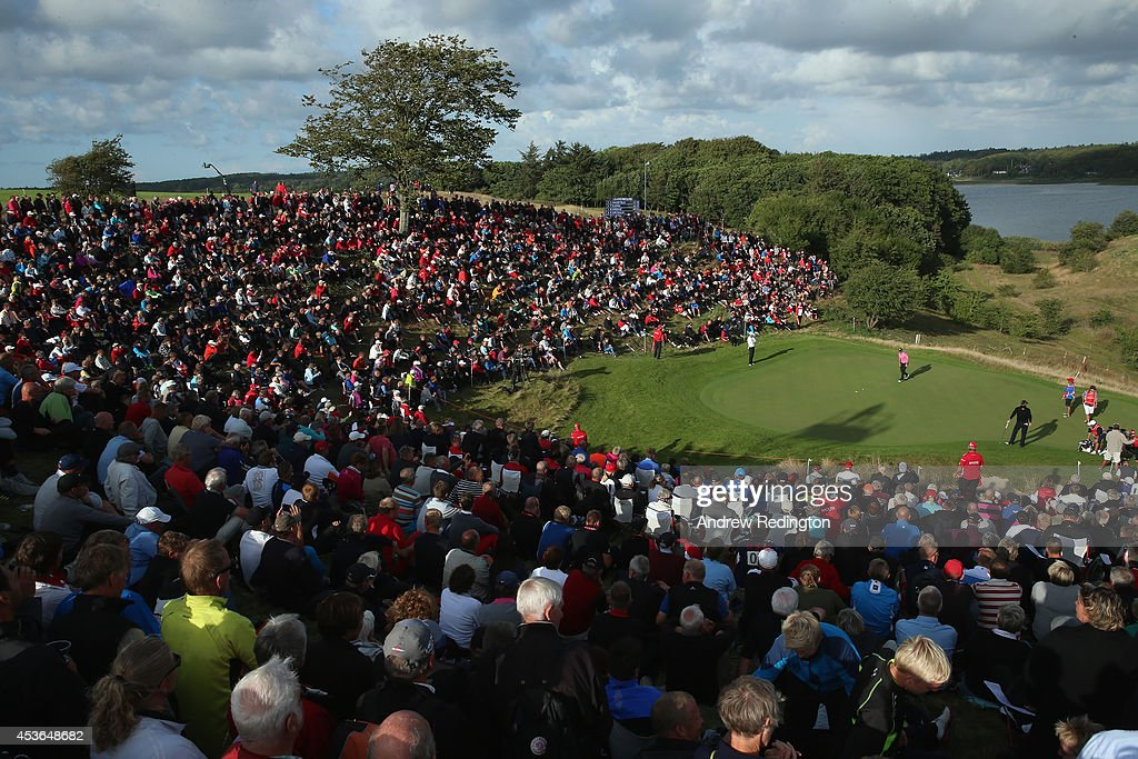 A general view of the 16th hole as Thomas Bjorn of Denmark Marc Warren of Scotland and Nicolas Colsaerts of Belgium putt during the second round of...