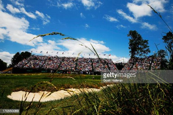A general view of the 17th green is seen as Tiger Woods of the United States Adam Scott of Australia and Rory McIlroy of Northern Ireland play during...