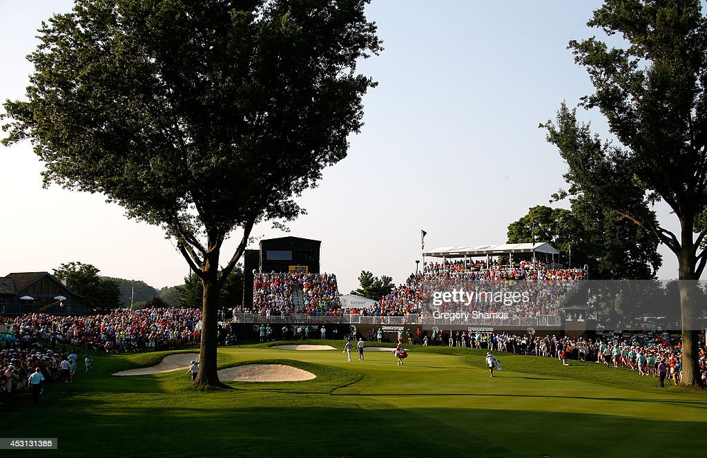 A general view of the 18th green as Sergio Garcia of Spain and Rory McIlroy of Northern Ireland walk on during the final round of the World Golf Championships-Bridgestone Invitational at Firestone Country Club South Course on August 3, 2014 in Akron, Ohio.
