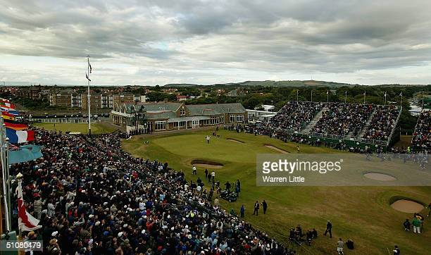 A general view of the 18th green is seen as Todd Hamilton of USA celebrates victory with his caddy Ron Levin at the 133rd Open Championship after a...