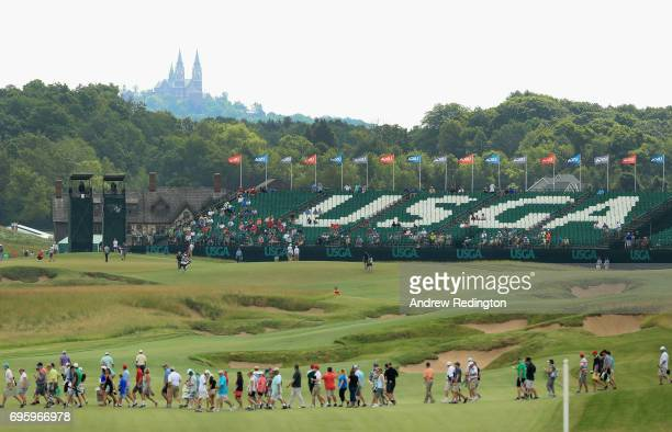 A general view of the 18th hole as fans walk across the course during a practice round prior to the 2017 US Open at Erin Hills on June 14 2017 in...