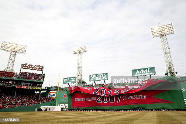A general view of the 2013 Championship banner as it is unfurled on the Green Monster during the opening ceremonies before the game between the...